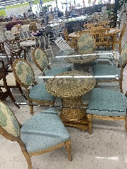 Coastal glass dining room table and six chairs