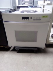 White electric Dacor wall oven