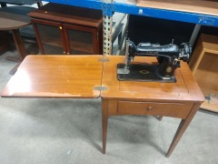 Singer Sewing Machine in Cabinet Table