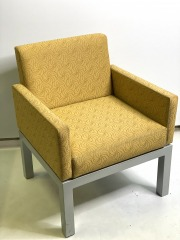 Yellow chair with steel legs