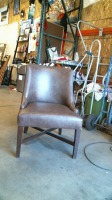 BROWN PLEATHER CHAIR 1\/4