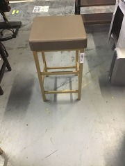 Metal Barstool with gold legs and brown leather seat