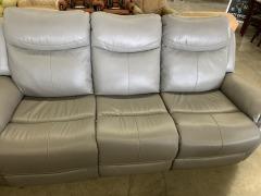 Grey simulated leather sofa